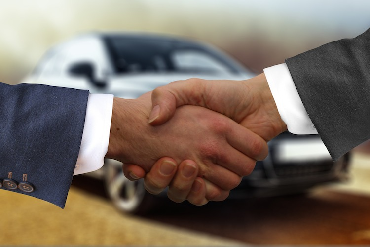 handshake car deal