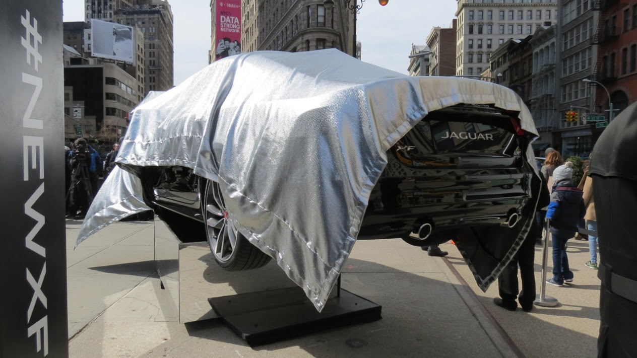 The rear fascia of the 2016 Jaguar XF is exposed in advance of a public reveal across the street from the historic Flatiron Building.